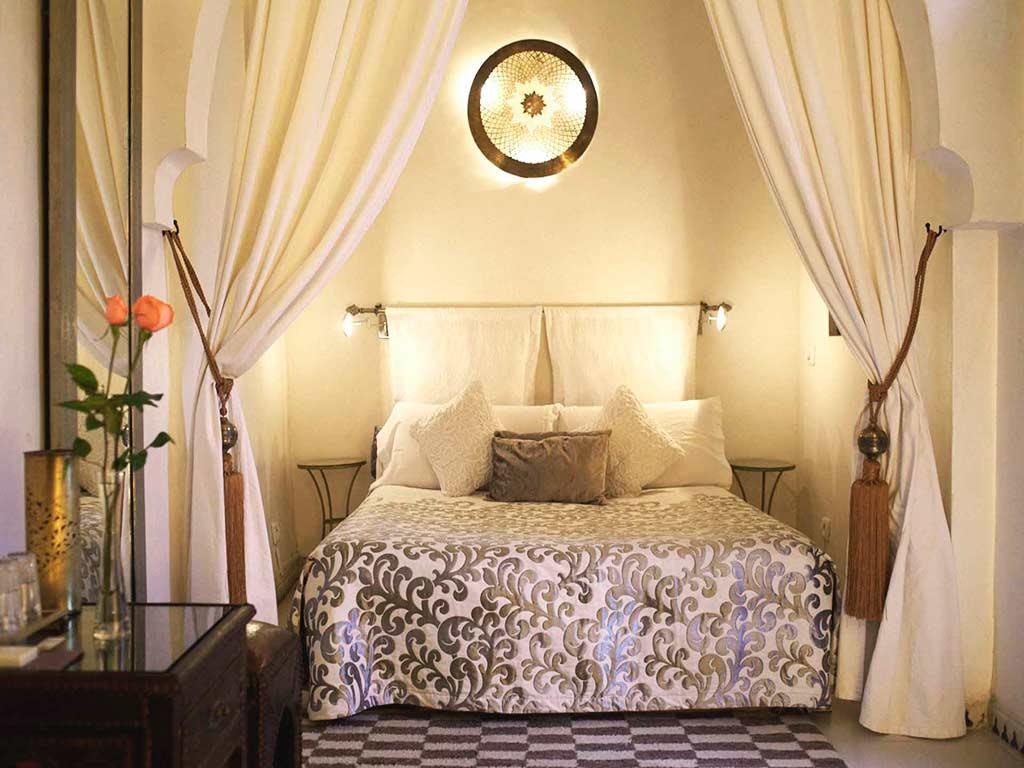 Bed in Baraka room. Moroccan style. Riad Aguaviva.